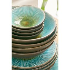 16-Piece Shangri-La Dinnerware Set (125 CAD) ❤ liked on Polyvore featuring home, kitchen & dining, dinnerware, turquoise, ceramic dinner plates, turquoise dinner plates, 4 piece dinnerware set, turquoise dinnerware set and ceramic dinnerware set