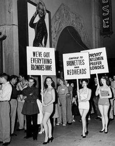 Brunettes picketing at the Marilyn Monroe movie premiere, 'Gentlemen Prefer Blondes'