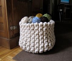 Knitting supplies, magazines, toys, blankets: You can store anything in these sturdy hand-knitted baskets. #countryliving