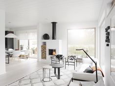 Such an organised space, beautiful modern fireplace and functional design. Scandinavian style all white interior