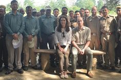Team photo: The royal couple pose for a photograph with smiling members of the forest guard inside the national park