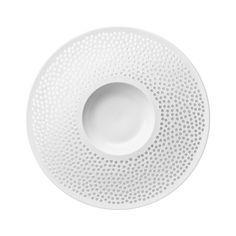The Cielo Dessert Plate is a unique and stylish tableware piece. The bisque porcelain is perforated by hand, and is both dishwasher and microwave proof.