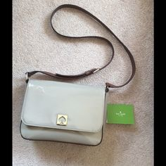 Beautiful Kate Spade Tan Patent Leather Bag In good condition with some slight discoloration on the back ( see photo) but still in perfect condition on the inside of the bag and all around. Brown strap. Please feel free to comment with questions! Comes with dust bag. kate spade Bags Crossbody Bags