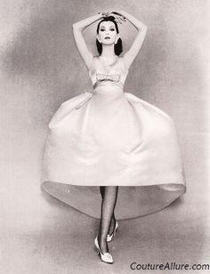 1958 Deep yellow satin dress with a huge bell shaped skirt by Balenciaga.