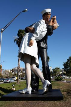 """""""The Kiss"""", a sailor kissing a nurse in Times Square following Truman's announcement in August 1945 the surrender of Japan. Originally photographed by Alfred Eisenstaedt for Life magazine. Many have claimed to be the nurse and sailor, but the mystery remains. The statue """"Unconditional Surrender"""" a 26-foot-tall statue by Seward Johnson is in Sarasota, FL. Sadly, the day I took a picture, someone later drove (not an easy task) into the statue and it has since been removed for repair."""