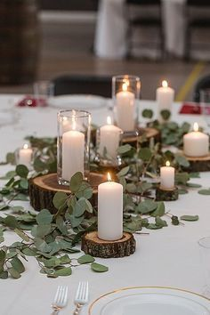 We love this rustic, woodland elegant table decor. Wood slaps of different heights with tall white candles and silver dollar eucalyptus. Briar Barn Inn, an inn and restaurant in south of Newburyport, Massachusetts. BriarBarnInn.com