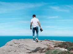 Photographer stood on the edge of a cliff with a camera Wedding Events, Our Wedding, Perfect Eyes, Wedding Story, Cliff, Videography, Professional Photographer, Wedding Pictures, Special Events