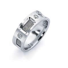 MEN'S JEWELRY    Under $1,000    Cobalt chrome with five diamonds and wire mesh background; $899; Heavy Stone Rings
