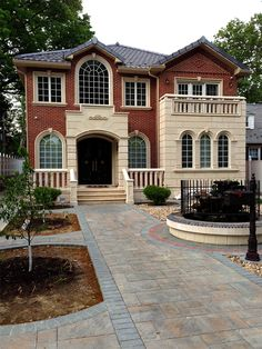 Architectural #Precast does wonders for a home and looks great as an accent next to brick veneer. This home has surrounds, keystones, wall panels, and a #balustrade system using precast concrete.