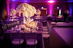 white flowers with pinspot lighting and flood the walls with purple..  it's an option