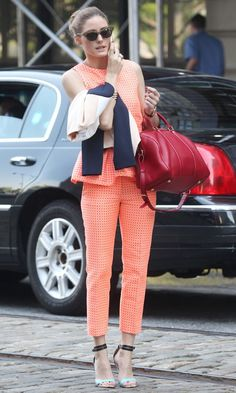 Olivia Palermo in orange MSGM suit with Louis Vuitton bag out in New York