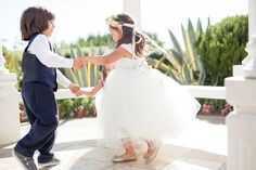 pure lavish events | st. regis monarch beach | blush and white wedding | luxury wedding | black tux | bride and groom | grand staircase | florals by Jenny | kaysha weiner photography | ring bearer | flower girl