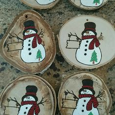 No two ornaments are ever identical even if I am burning and painting them with the same picture...nature takes care of adding it's own touches to make each one unique.  These snowmen have a tree instead of the heart for a custom order.