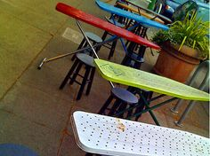 Using old metal ironing boards as tables for patio or snack shop.