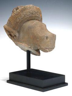 Tiroche Auction House A KHMER STONE HORSE HEAD OF VAJIMUKHA A KHMER STONE HORSE HEAD OF VAJIMUKHA Angkor period, 11th/12th century 22 cm high; 27 cm long Plinth 6,000 - 5,000 $