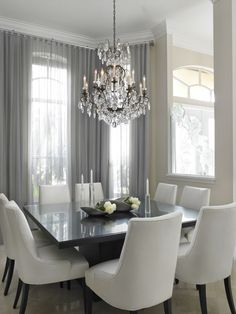 This stunning gray and white dining space was completed by Sheryl Bleustein Interiors. #luxeFL