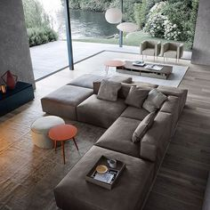 With this #outstanding #couch the designers Livarea created an ode to #cosiness! The #beautiful #setting by the #lake contributes to this #wonderful #livingroom. Check out #homify for cool #furniture and #unique #accessories for your #home! #architecture #design #interior #interiordesign #modernliving #sofa #window #nature #relax