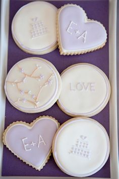 Sugar cookies in lavender and cream are embellished with soft details that send a message of love. Shauna Younge Dessert Tables