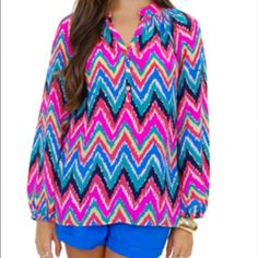 Lilly Pulitzer Silk Top 100% Silk. Multi colored chevron print. Worn a handful of times.  Excellent condition   NO TRADES OR PAYPAL.  LOWEST PRICE  NO FURTHER REDUCTIONS Lilly Pulitzer Tops