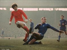 George Best gets a shot in before an attempted tackle by Ron Harris. Manchester United vs. Chelsea.