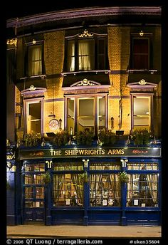 Building housing the pub Shipwrights Arms at night. London, England, United Kingdom (color)
