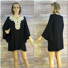 """Black Bell Sleeve Dress with Lace Detail New without tags and direct from the distributor. This flowing dress is a size small and made in the USA. It has pretty flowing bell shaped sleeves and a beautiful ivory lace detail in the front. Approximately 30"""" long from shoulder to bottom hem, and 18"""" arm pit to arm pit. This is a loose and flowing dress that could probably accommodate a size medium as well. 95% rayon and 5% spandex. Smoke free home. Dresses Midi"""