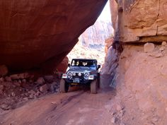 My Rubi under the big rock at Long Canyon Trail outside Moab, UT