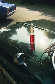By William Eggleston, American photographer born in 1939. Eggleston's use of intense colour, uneasy composition and disconcerting subject matter bought him to prominence and gained acceptance for colour photography as art.