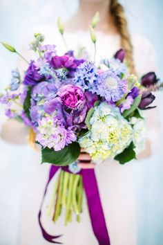 For a Frozen themed wedding : bright purple and icy blue bouquet by Calie Rose