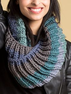 Free Knitting Pattern for 2 Row Repeat Big Rib Cowl - This large twisted cowl features a 2 row repeat fishermen rib stitch and is knit with one skein of the recommended yarn. Quick knit in super bulky yarn. Designed by Caron Design Team. Great with multi-colored yarn