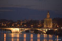 San Telmo Bridge, Torre del Oro and Guadalquivir River in Seville, Spain