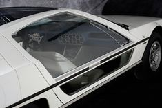 1967 Lamborghini Marzal. Styled by Marcello Gandini (Bertone). Introduced at the 1967 Geneva Motor Show. 1964cc/121.9cu.in. inline 6 (half of their V12), 3 Weber 40DCOE carburetors, 130.5kw/175.0bhp @6800 rpm, 178.97nm/132.0ft-lbs @4600rpm. The engine was placed behind the rear axle. Chassis was based on an extended Miura platform.