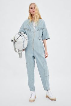 """Last time I left a Zara store, I lugged a giant shopping bag eight blocks and canceled my SoulCycle ride after. """"Shopping is my cardio"""" has never Moda Zara, Cropped Denim Jacket, Denim Jumpsuit, Dungarees, Long Jumpsuits, Jumpsuits For Women, Zara Fashion, Fashion Outfits, Jeans Overall"""