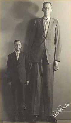 The tallest man who ever lived, Robert Wadlow, with his father, who appears grumpy probably because of all the money he had to spend on his ...