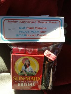 party favors for the Jr. Astronauts Snack Pack:  SUNmaid Raisins  MILKY WAY bar  STARburst Candies