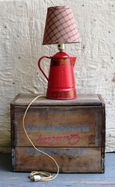 Vintage 1940s-1950s  Cute lamp made from an old tin coffee pot  Painted red and decorated with PA Dutch style decals  Paired with a newer lamp