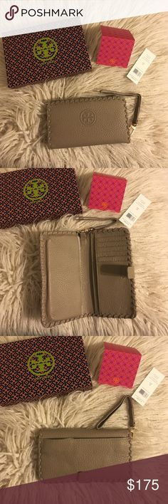 """Tory Burch Marion Smartphone Bi-fold Wristlet NWT Tory Burch Marion Smartphone Bifold Wristlet! It's the all-in-one for your mobile - it fits an iPhone 6 - and your cash and cards. Made of super-soft pebbled leather, it features plenty of pockets and compartments. Color is French gray!  * Fold-over pin snap closure * Removable wriststrap * Fits an iPhone 5 and 6 * Length: 6.97""""  * Height: 3.98""""  No trades No lowballing ✅Bundle Discount  Authentic items  ✨purchase at listed price get a free…"""