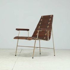 Rare Mid-Century Modern Chair in Oregon Pine and Metal | From a unique collection of antique and modern lounge chairs at http://www.1stdibs.com/furniture/seating/lounge-chairs/