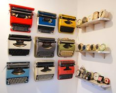 Love these Vintage typewriters & clocks as an art display -   Collectibles on a wall.