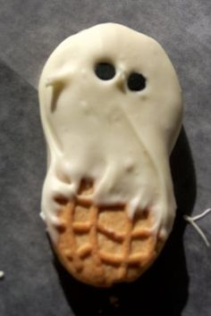 ghosts . . .  Nutter Butters dipped in white chocolate with mini chocolate chip eyes