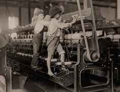 The History Place - Child Labor in America 1908-12: Lewis Hine Photos - The Mill. The Mill: Some boys and girls were so small they had to climb up on to the spinning frame to mend broken threads and to put back the empty bobbins. Bibb Mill No. 1. Macon, Georgia.