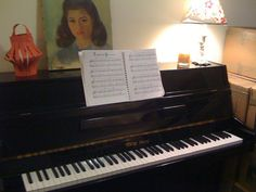 Painting of Jeffrey's mom on top of piano     Classic musical instruments