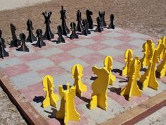 An outdoor chess board can be scaled to fit your own big or small backyard. These 25 ideas will get you started with outdoor chess.