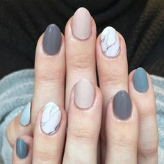 13 best summer nail art ideas: Set in stone; go for cool grey colors with a fun white marble party nail to create a look stone cool.