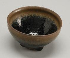 "TEMMOKU POTTERY TEA BOWL With black and brown hare's-fur glaze. Diameter 3.5"" (8.8 cm)."