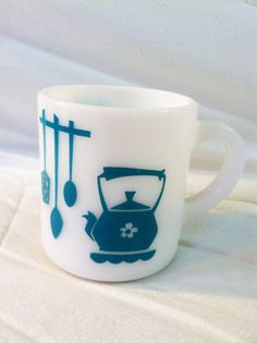 Cute Vintage milk glass mug with teal design by EvelynandGeorge on Etsy.