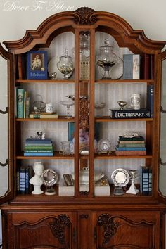 Line the back of a bookcase or shelves with pages from a large book. This one is the glossary of an atlas. Via Decor to Adore.
