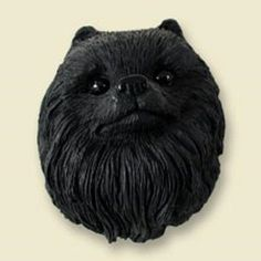 This black Pomeranian dog magnet is perfect for your kitchen refrigerator decor. It is a cute little collector's item that measure about 2 inches in dimension. Magnets are hand painted and made from s