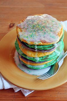King Cake Pancakes  Happy Fat Tuesday, everyone!   Kick off the Mardi Gras season right with a big ol' stack of these festive King Cake Pancakes. You read right. These pancakes taste just like traditional King Cake, but in breakfast form! They're sweet, tart, easy to make and full of deliciousness – the perfect way to celebrate Carnival.