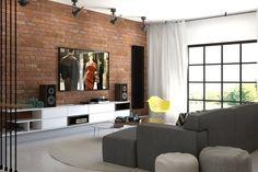 rote Ziegelwand, weißes Low-Board und graues Sofa